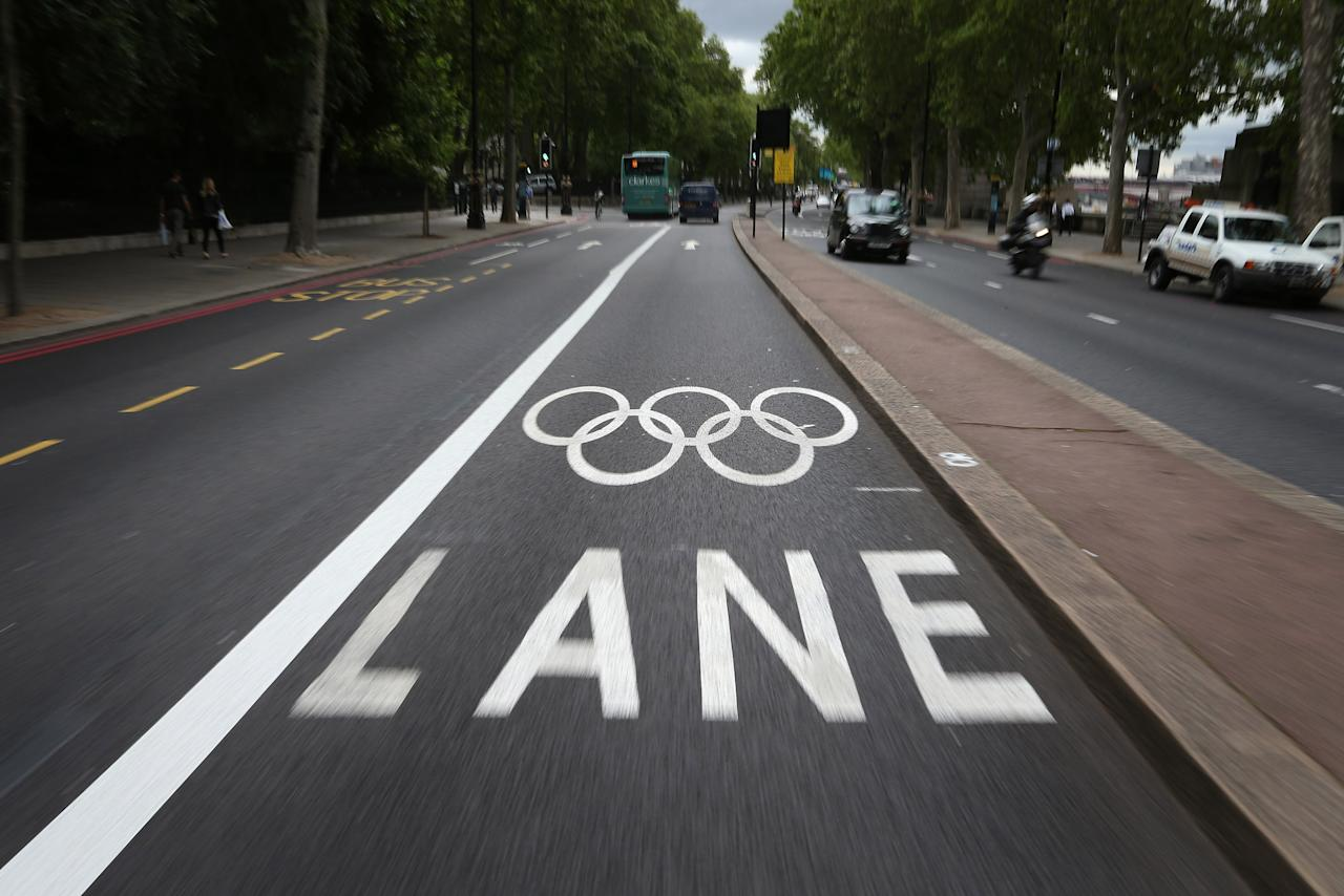 LONDON, ENGLAND - JULY 17:  A road is marked out with an Olympic Games Lane on July 17, 2012 in London, England. Competitors and officials have started to arrive ahead of the London 2012 Olympic Games.  (Photo by Peter Macdiarmid/Getty Images)
