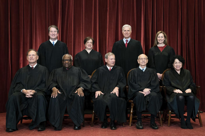 In this April 23, 2021, file photo, members of the Supreme Court pose for a group photo at the Supreme Court in Washington. Seated from left are Associate Justice Samuel Alito, Associate Justice Clarence Thomas, Chief Justice John Roberts, Associate Justice Stephen Breyer and Associate Justice Sonia Sotomayor, Standing from left are Associate Justice Brett Kavanaugh, Associate Justice Elena Kagan, Associate Justice Neil Gorsuch and Associate Justice Amy Coney Barrett. The Supreme Court is wrapping up its first all-virtual term, with decisions expected in a key case on voting rights and another involving information California requires charities to provide about donors. The court's last day of work Thursday, July 1, before its summer break also could include a retirement announcement, although the oldest of the justices, 82-year-old Stephen Breyer, has given no indication he intends to step down this year. (Erin Schaff/The New York Times via AP, Pool)