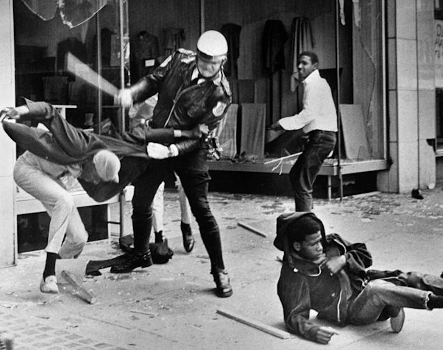 A police officer uses his nightstick on a youth reportedly involved in the looting that followed the breakup of a march led by King on March 28, 1968, in Memphis. (Photo: Jack Thornell/AP)