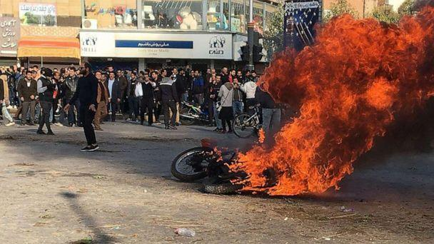 PHOTO: Iranian protesters gather around a burning motorcycle during a demonstration against an increase in gasoline prices in the central city of Isfahan, on Nov. 16, 2019. (AFP via Getty Images, FILE)