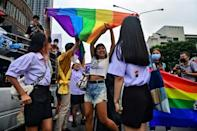 The Bangkok parade drew a mix of feminists, sex workers and LGBTQ activists