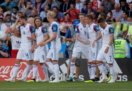 Soccer Football - World Cup - Group D - Argentina vs Iceland - Spartak Stadium, Moscow, Russia - June 16, 2018 Iceland's Alfred Finnbogason celebrates scoring their first goal with Birkir Mar Saevarsson and team mates REUTERS/Maxim Shemetov