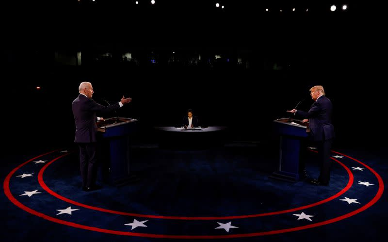 FILE PHOTO: Democratic presidential nominee Biden and President Trump participate in their second debate in Nashville