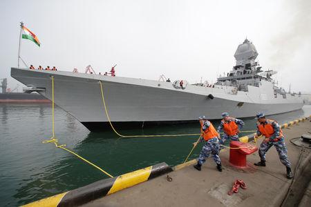 Chinese navy personnel moor the Indian Navy warship INS Kolkata at Qingdao Port for the 70th anniversary celebrations of the founding of the Chinese People's Liberation Army Navy (PLAN), in Qingdao, China, April 21, 2019. REUTERS/Jason Lee