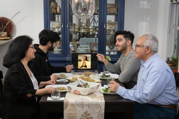 Alavi and her family eat for the first time since sunrise, with two of her children, Sama and Neda, joining via Zoom.