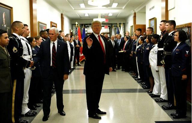 President Trump and Vice President Mike Pence greet military personnel at the Pentagon. (Photo: Kevin Lamarque/Reuters)