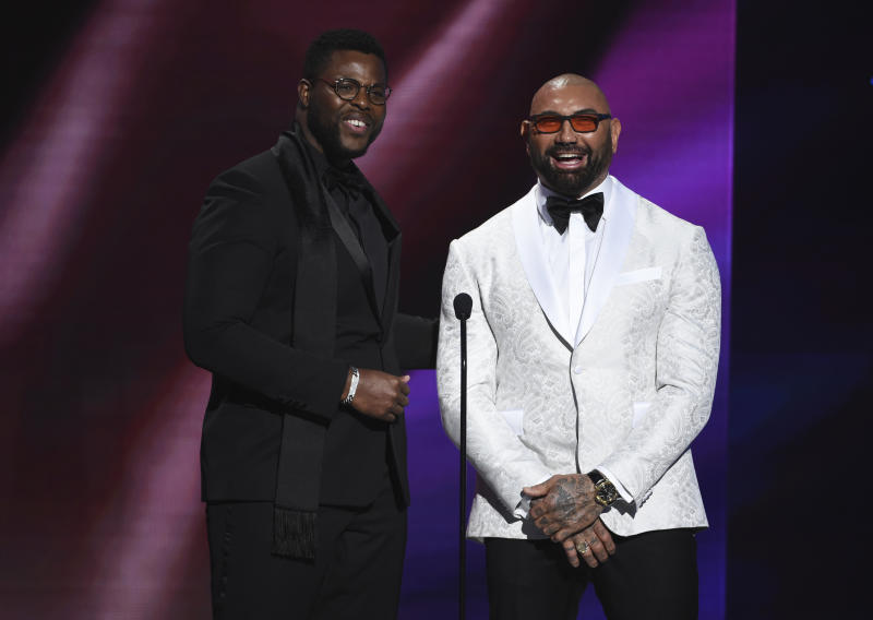 Winston Duke, left, and Dave Bautista speak onstage at the 51st NAACP Image Awards at the Pasadena Civic Auditorium on Saturday, Feb. 22, 2020, in Pasadena, Calif. (AP Photo/Chris Pizzello)