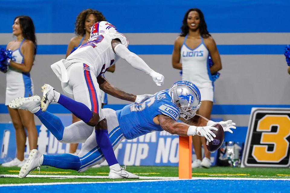 Detroit Lions running back Craig Reynolds (46) scores a touchdown against the Buffalo Bills during the second half of the preseason game at Ford Field in Detroit on Friday, Aug. 13, 2021.
