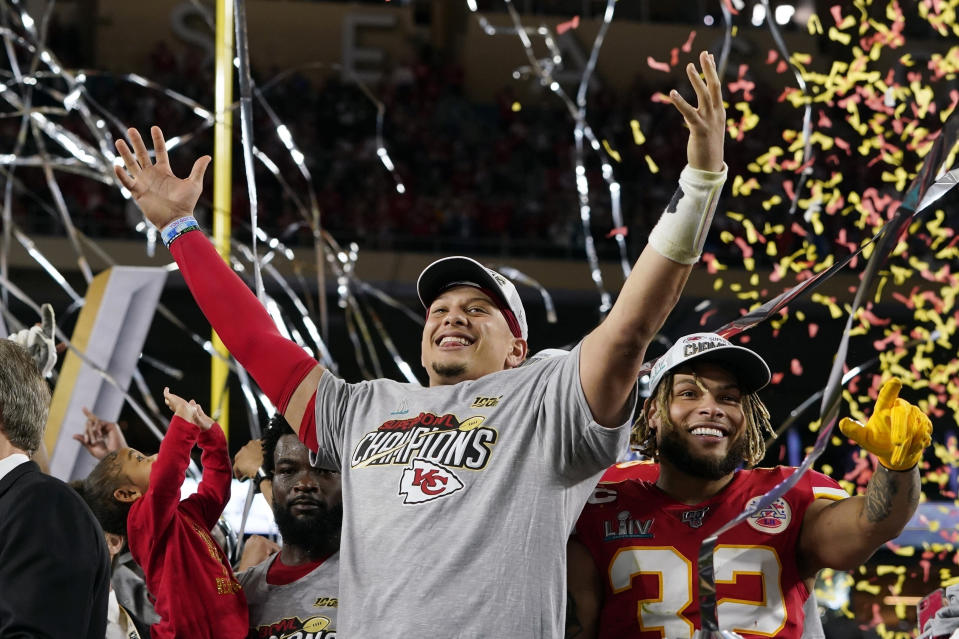 FILE - In this Feb. 2, 2020, file photo, Kansas City Chiefs' Patrick Mahomes, left, and Tyrann Mathieu celebrate after defeating the San Francisco 49ers in the NFL Super Bowl 54 football game in Miami Gardens, Fla. (AP Photo/David J. Phillip, File)