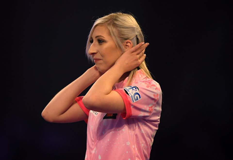 LONDON, ENGLAND - DECEMBER 17:  Fallon Sherrock reacts after winning her 1st round game against Ted Evetts to become the first female to win a game in the PDC World Championships during Day 5 of the 2020 William Hill Darts Championship  at Alexandra Palace on December 17, 2019 in London, England. (Photo by Alex Davidson/Getty Images)