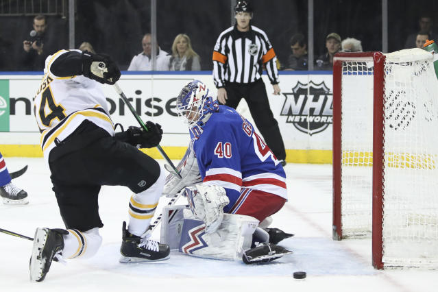 New York Rangers goaltender Alexandar Georgiev (40) makes a save against Boston Bruins left wing Jake DeBrusk (74) during the first period of an NHL hockey game, Sunday, Feb. 16, 2020, at Madison Square Garden in New York. (AP Photo/Mary Altaffer