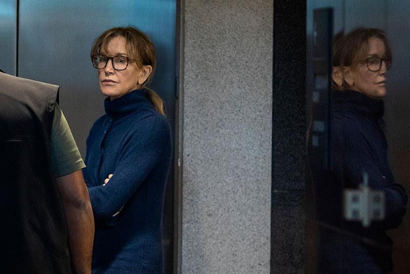 Actress Felicity Huffman is seen inside the Edward R. Roybal Federal Building and U.S. Courthouse in Los Angeles, on March 12, 2019. - Two Hollywood actresses including Oscar-nominated 'Desperate Housewives' star Felicity Huffman are among 50 people indicted in a nationwide university admissions scam, court records unsealed in Boston on March 12, 2019 showed. The accused, who also include chief executives, allegedly cheated to get their children into elite schools, including Yale, Stanford, Georgetown and the University of Southern California, federal prosecutors said.Huffman, 56, and Lori Loughlin, 54, who starred in 'Full House,' are charged with conspiracy to commit mail fraud and honest services mail fraud. A federal judge set bond at $250,000 for Felicity Huffman after she was charged in a massive college admissions cheating scandal. (Photo by DAVID MCNEW / AFP) (Photo credit should read DAVID MCNEW/AFP/Getty Images)