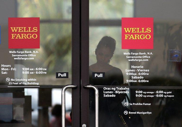 A customer leaves a Wells Fargo bank branch office on July 12, 2012 in Daly City, California