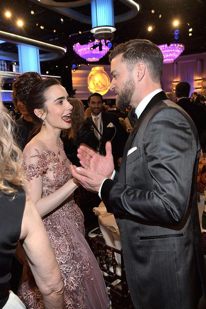 Wow, to be a fly on that wall, as Lily Collins talks to Justin Timberlake. (Photo: Getty Images)