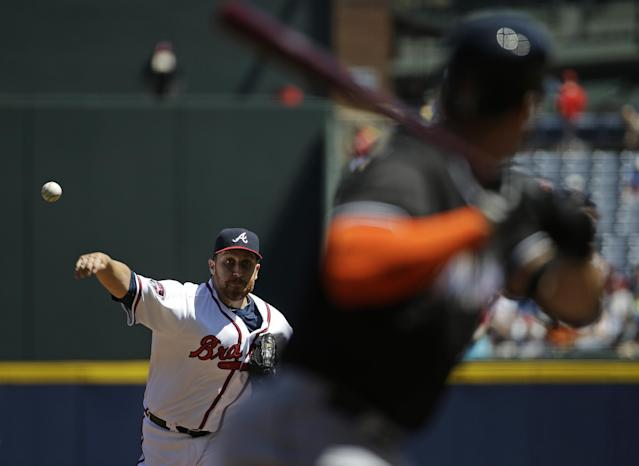 Atlanta Braves starting pitcher Aaron Harang, left, throws to Miami Marlins' Giancarlo Stanton in the first inning of a baseball game, Wednesday, April 23, 2014, in Atlanta. (AP Photo/David Goldman)