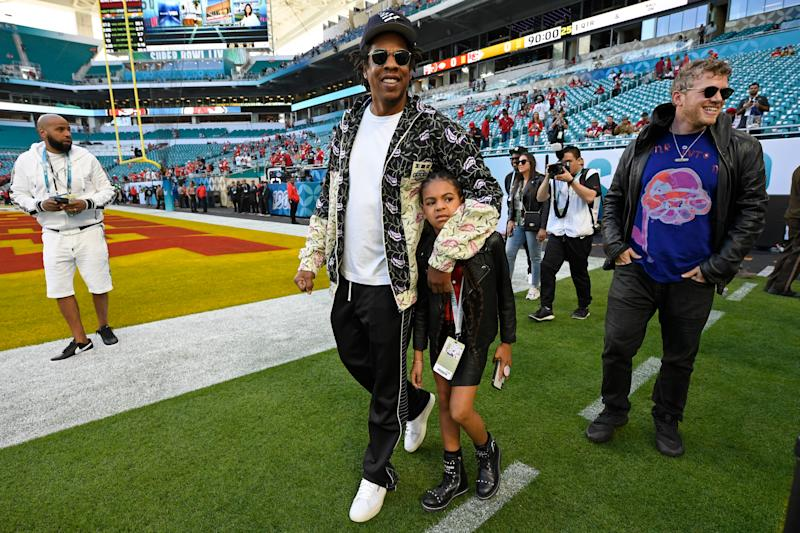 MIAMI GARDENS, FLORIDA - FEBRUARY 2: Jay-Z walks with his daughter Blue Ivy Carter as they tour the field before the start of Super Bowl LIV at Hard Rock Stadium in Miami Gardens, Fla., on Sunday, Feb. 2, 2020. (Jose Carlos Fajardo/MediaNews Group/The Mercury News via Getty Images)