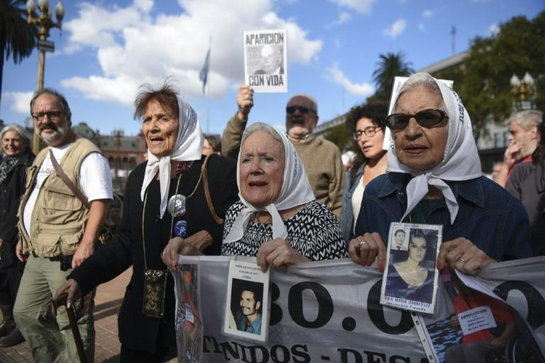 Members of the Argentine human rights group Madres de Plaza de Mayo, (from L) Taty Almeida, Nora Cortinas and Mirta Acuna de Baravalle take part in the weekly march at the Plaza de Mayo square in Buenos Aires, on April 20, 2017