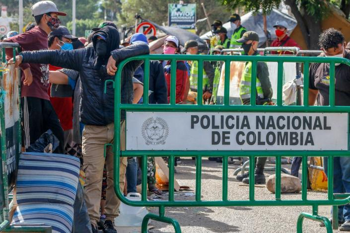 """<span class=""""caption"""">Venezuelans wait at the Colombian border to be processed and housed in tents in 2020. All Venezuelans now in Colombia will receive a 10-year residency permit.</span> <span class=""""attribution""""><a class=""""link rapid-noclick-resp"""" href=""""https://www.gettyimages.com/detail/news-photo/venezuelans-queue-as-they-are-being-transferred-from-the-news-photo/1219988930?adppopup=true"""" rel=""""nofollow noopener"""" target=""""_blank"""" data-ylk=""""slk:Schneyder Mendoza/AFP via Getty Images"""">Schneyder Mendoza/AFP via Getty Images</a></span>"""
