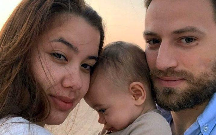 Caroline Crouch with her husband and baby daughter