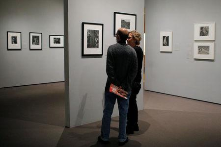 "Visitors look at the exhibit ""Imogen Cunningham: In Focus"" at the Museum of Fine Arts, Boston, in Boston"
