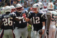 New England Patriots running back Sony Michel (26) congratulates quarterback Tom Brady (12) after Brady scored a touchdown, during the second half at an NFL football game against the Miami Dolphins, Sunday, Sept. 15, 2019, in Miami Gardens, Fla. (AP Photo/Lynne Sladky)