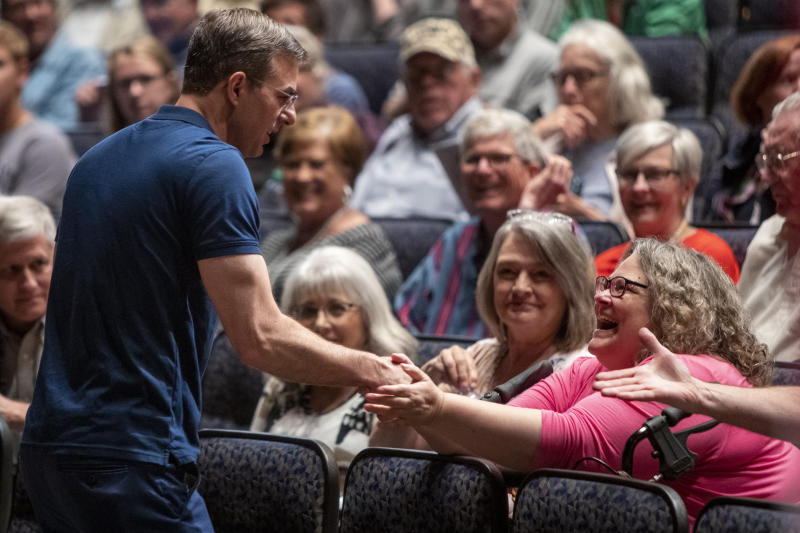 U.S. Rep. Justin Amash, R-Cascade Township, greets the crowd before holding a town hall meeting at Grand Rapids Christian High School's DeVos Center for Arts and Worship on Tuesday, May 28, 2019. The congressman came under scrutiny May 18 when he posted a series of Tweets to outline his support for impeachment proceedings. As such, he is the only Republican congress member to do so. The following days brought an announcement from the wealthy DeVos family about no longer supporting him financially. (Cory Morse/The Grand Rapids Press via AP)