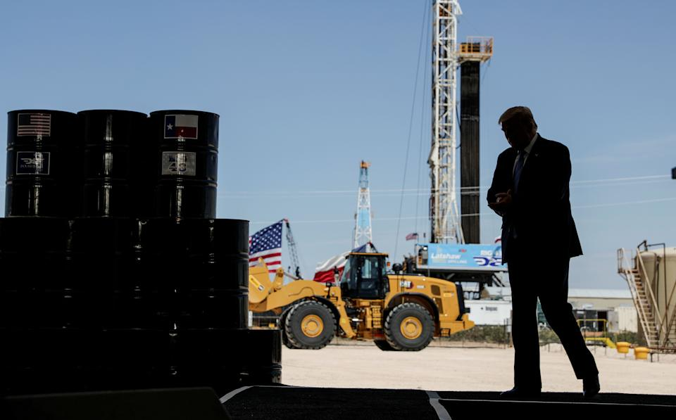 President Donald Trump arrives to deliver a speech during a tour of an oil rig in Midland, Texas, in July. a (Photo: Carlos Barria/Reuters)