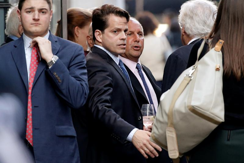 Anthony Scaramucci stands outside the Le Cirque restaurant with others before a fundraising event for Republican presidential candidate Donald Trump in Manhattan, New York City, U.S., June 21, 2016. REUTERS/Mike Segar