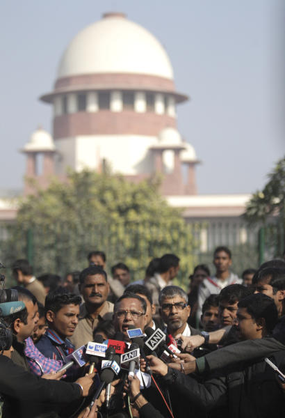 Indian lawyers address the media outside the Supreme Court after the top court ruled that a colonial-era law criminalizing homosexuality will remain in effect in India in New Delhi, India, Wednesday, Dec. 11, 2013. The Supreme Court threw out a 2009 New Delhi High Court decision that struck down the law as unconstitutional, dealing a blow to gay activists who have argued for years for the chance to live openly in India's deeply conservative society. The top court said it was for lawmakers and not the courts to decide the matter. (AP Photo/Tsering Topgyal)