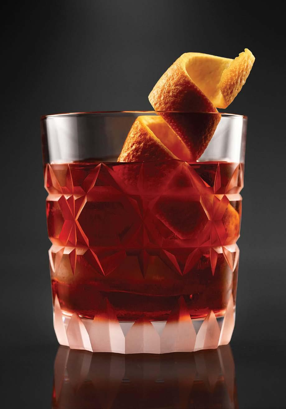 """This rich riff on the classic bittersweet <a href=""""https://www.epicurious.com/recipes/food/views/negroni-56390123?mbid=synd_yahoo_rss"""" rel=""""nofollow noopener"""" target=""""_blank"""" data-ylk=""""slk:Negroni cocktail"""" class=""""link rapid-noclick-resp"""">Negroni cocktail</a> is made with rum and a rich blend of oloroso and Pedro Ximénez sherries. <a href=""""https://www.epicurious.com/recipes/food/views/east-india-negroni-rum-campari-cocktail?mbid=synd_yahoo_rss"""" rel=""""nofollow noopener"""" target=""""_blank"""" data-ylk=""""slk:See recipe."""" class=""""link rapid-noclick-resp"""">See recipe.</a>"""