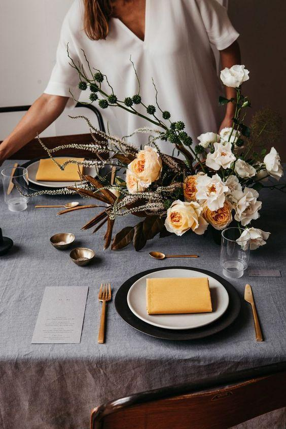 """<p>Gray doesn't have to automatically equal dark and somber. The addition of yellow lifts this tablescape without sacrificing any depth or texture. </p><p><a class=""""link rapid-noclick-resp"""" href=""""https://www.hildestories.com/london-autumn/"""" rel=""""nofollow noopener"""" target=""""_blank"""" data-ylk=""""slk:See more at Hilde"""">See more at Hilde</a></p>"""