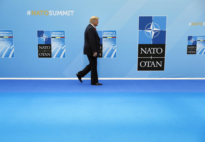 President Donald Trump walks in as he is introduced at the summit of heads of state and government at NATO headquarters in Brussels on Wednesday, July 11, 2018. NATO leaders gather in Brussels for a two-day summit to discuss Russia, Iraq and their mission in Afghanistan. (AP Photo/Pablo Martinez Monsivais)