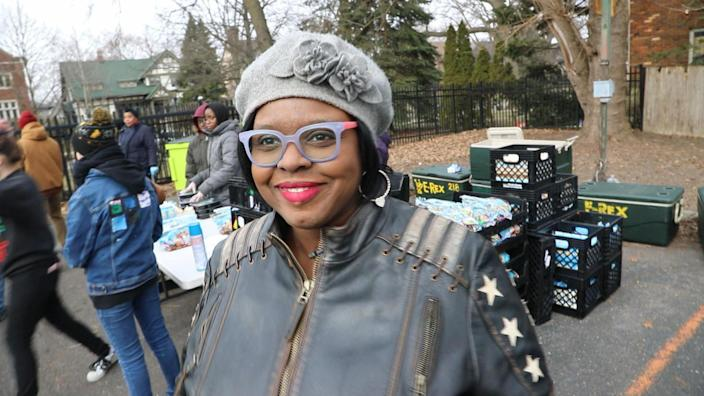 Kinda Makini-Anderson runs Inner City Youth Group, a small nonprofit serving Detroit's East Side. Makini-Anderson is pictured at a food distribution she ran in March. (Jake Whitman)