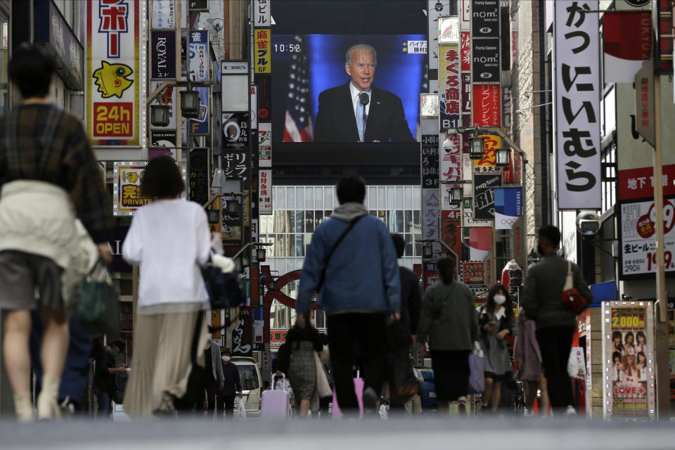 A screen shows a broadcast of President-elect Joe Biden speaking Sunday, Nov. 8, 2020 at the Shinjuku shopping district in Tokyo. (AP Photo/Kiichiro Sato)