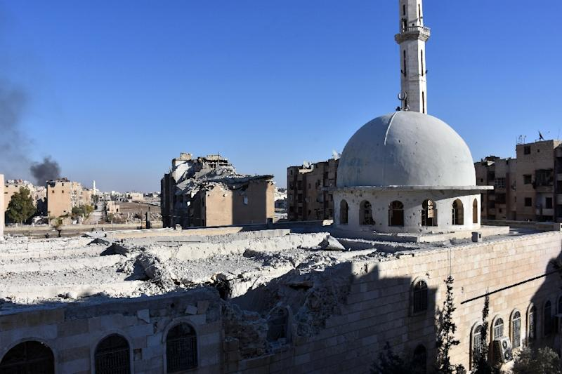 A damaged mosque stands in the Masaken Hanano district in eastern Aleppo, a day after Syrian pro-government forces seized it from rebel fighters (AFP Photo/George Ourfalian)