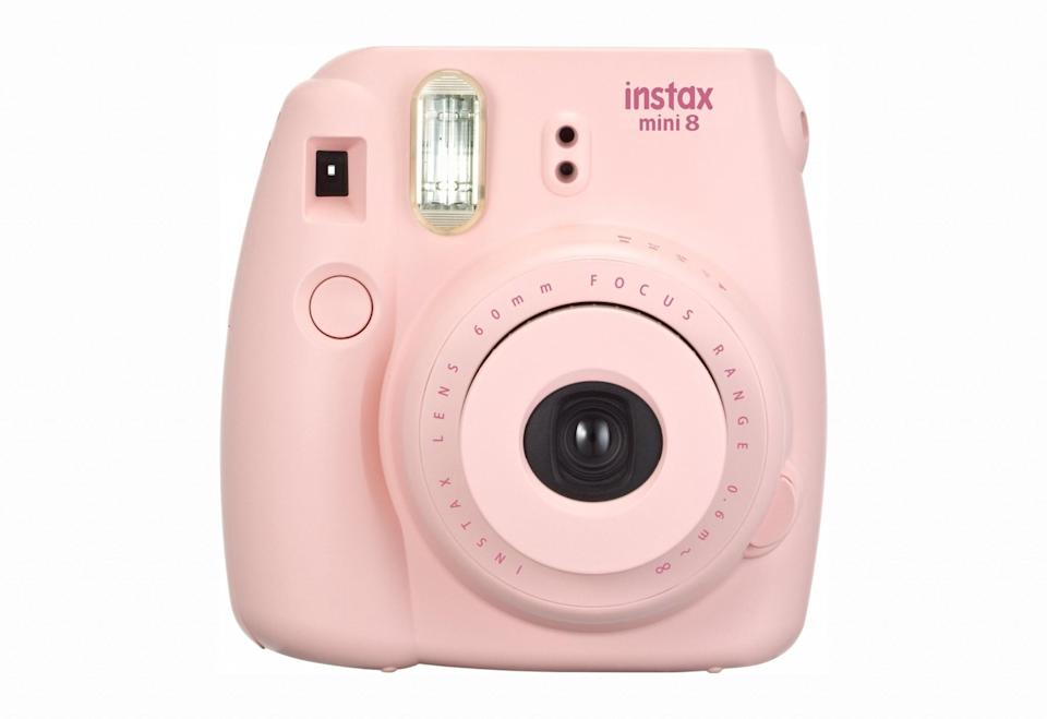 <p>Complete with a cute, compact body, this Instax camera prints instant pics – perfect for weekends away or girls' nights out. </p>