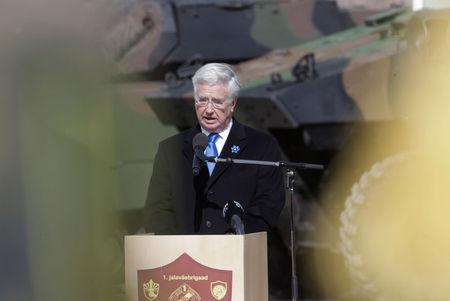 Britain's Defence Secretary Michael Fallon speaks during the official ceremony welcoming the deployment of a multi-national NATO battalion in Tapa, Estonia, April 20, 2017. REUTERS/Ints Kalnins