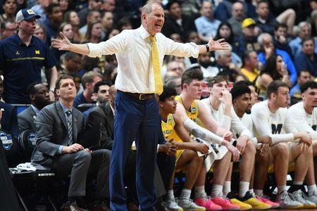 FILE PHOTO: March 28, 2019; Anaheim, CA, USA; Michigan Wolverines head coach John Beilein reacts watching game action against the Texas Tech Red Raiders during the second half in the semifinals of the west regional of the 2019 NCAA Tournament at Honda Center. Mandatory Credit: Robert Hanashiro-USA TODAY Sports