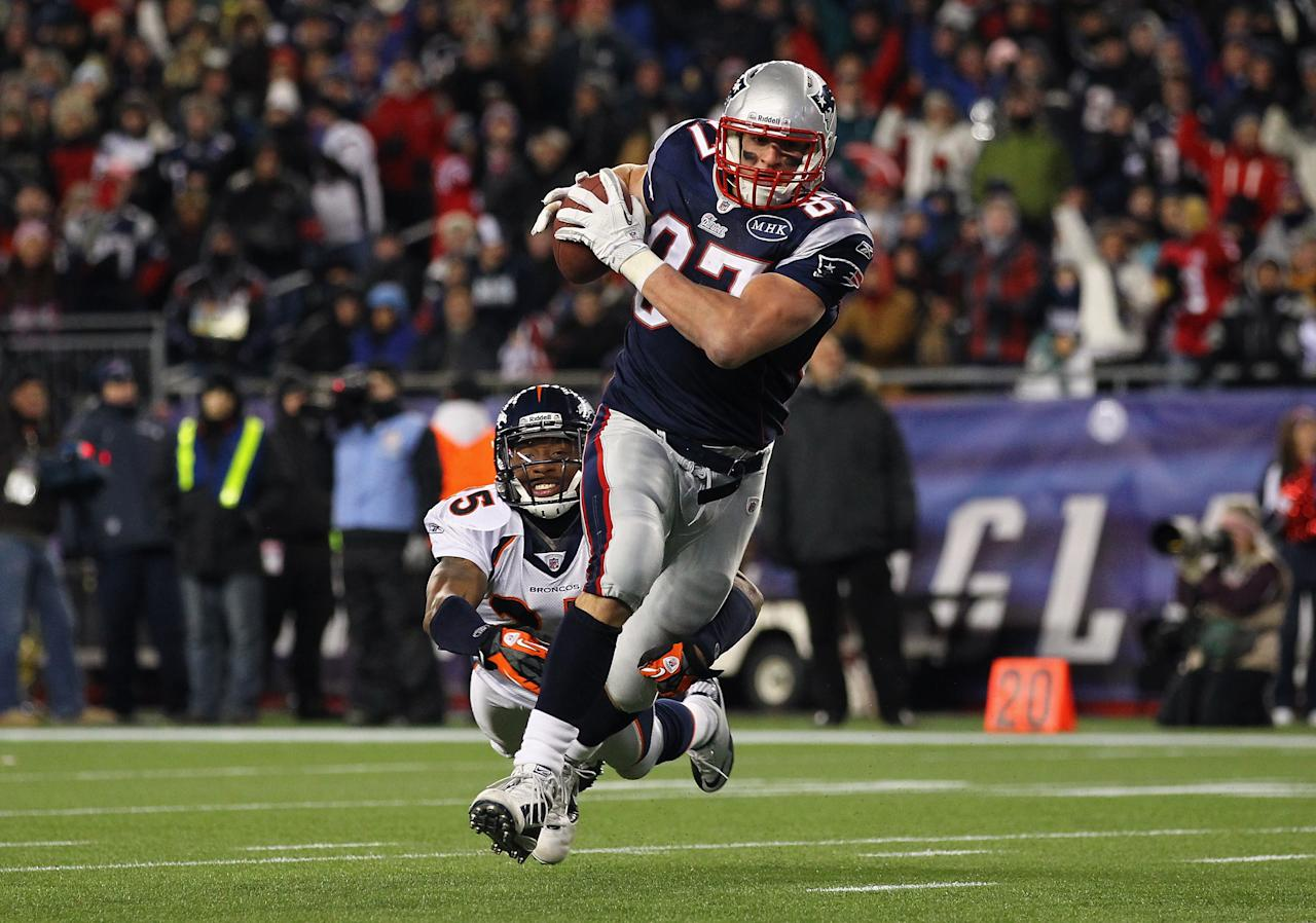 FOXBORO, MA - JANUARY 14:  Rob Gronkowski #87 of the New England Patriots scores a 12-yard touchdown reception in the seocnd quarter against Chris Harris #25 of the Denver Broncos during their AFC Divisional Playoff Game at Gillette Stadium on January 14, 2012 in Foxboro, Massachusetts.  (Photo by Al Bello/Getty Images)