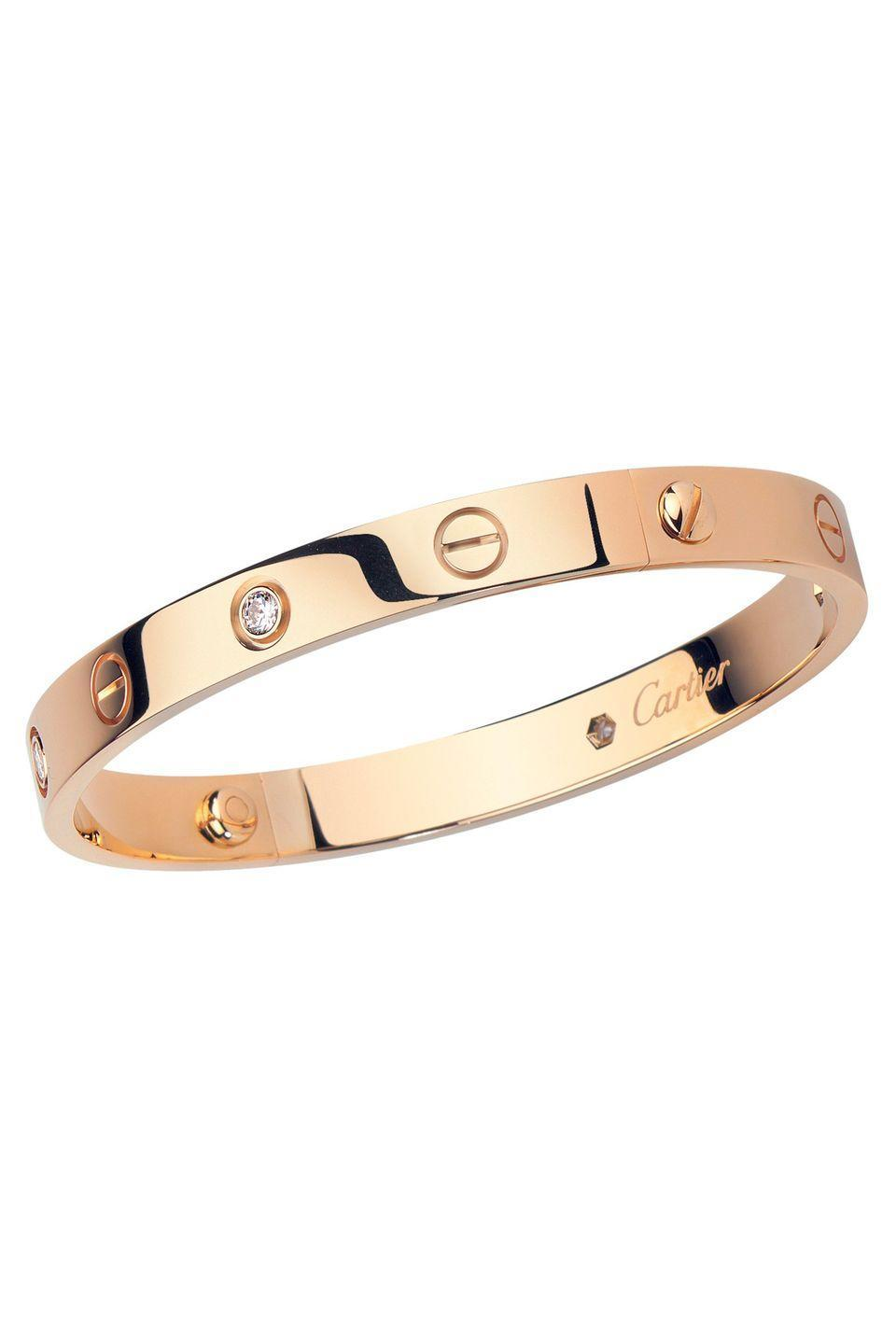 """<p><a class=""""link rapid-noclick-resp"""" href=""""http://www.cartier.co.uk/en-gb/collections/jewelry/collections/love/bracelets/b6035617-love-bracelet.html"""" rel=""""nofollow noopener"""" target=""""_blank"""" data-ylk=""""slk:SHOP NOW"""">SHOP NOW</a></p><p>The Love bangle is one of the most searched-for pieces of jewellery on Google, and with good reason; it's an iconic, easy-to-wear piece imbued with a romantic underlying message. </p><p>Created by Italian jewellery designer Aldo Cipullo for <a href=""""https://www.harpersbazaar.com/uk/fashion/jewellery-watches/a35418680/cartier-classics/"""" rel=""""nofollow noopener"""" target=""""_blank"""" data-ylk=""""slk:Cartier"""" class=""""link rapid-noclick-resp"""">Cartier</a> in 1969, the bracelet was intended as a 'modern handcuff' for men or women: its oval shape sits as close to the skin as possible and it is secured around your wrist with tiny screws to signify the permanence of true love. </p><p> Legend has it that when the bracelet was first launched, Cartier gifted pairs of them to some of the most famous couples of the 20th century, including the Duke and Duchess of Windsor; Elizabeth Taylor and Richard Burton; Ali MacGraw and Steve McQueen; and Sophia Loren and Carlo Ponti. </p><p>Over 50 years later, the bracelet is still so popular, it is said New York hospitals keep mini Love screwdrivers on hand in case they need to remove bracelets from patients in an emergency. </p><p>Pink gold Love bracelet, £5,400, <a href=""""https://www.cartier.co.uk/en-gb/collections/jewelry/collections/love/bracelets/b6035617-love-bracelet.html"""" rel=""""nofollow noopener"""" target=""""_blank"""" data-ylk=""""slk:Cartier"""" class=""""link rapid-noclick-resp"""">Cartier</a></p>"""