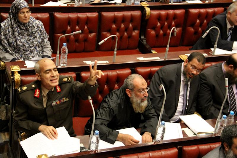 Members of the constitutional assembly attend a session to vote on a final draft of a new Egyptian constitution in Cairo, Egypt, Thursday, Nov. 29, 2012. An Islamist-dominated panel began a fast-track vote on a final draft of a new Egyptian constitution Thursday, pushing through the document despite liberals' boycott in a move likely to stoke a deepening political crisis between the Islamist president and the opposition.(AP Photo/Mohammed Abu Zaid)