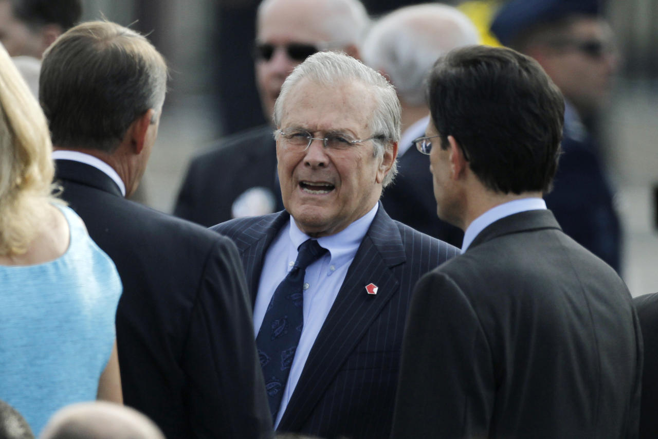Former U.S. Secretary of Defense Donald Rumsfeld (C) talks to Speaker of the House John Boehner (L) and House Majority Leader Eric Cantor (R) as they gather for ceremonies marking the 10th anniversary of the 9/11 attack on the Pentagon, in Washington September 11, 2011.  (REUTERS/Jason Reed)