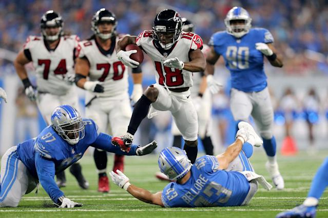 <p>Taylor Gabriel #18 of the Atlanta Falcons runs over Armonty Bryant #97 of the Detroit Lions and Nick Bellore #43 during the first quarter action at Ford Field on September 24, 2017 in Detroit, Michigan. (Photo by Rey Del Rio/Getty Images) </p>