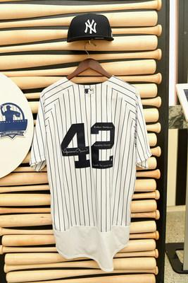 An authentic Yankees jersey and hat, signed by Mariano Rivera, are among the many items available for purchase on eBay.