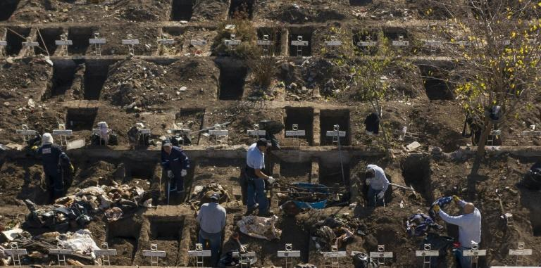Workers dig graves in Santiago's General Cemetery after health authorities ordered them to prepare for a possible surge in deaths from COVID-19 (AFP Photo/MARTIN BERNETTI)
