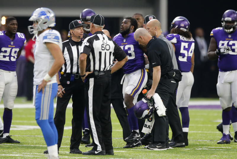 Minnesota Vikings running back Dalvin Cook is helped off the field after getting injured against the Detroit Lions. More