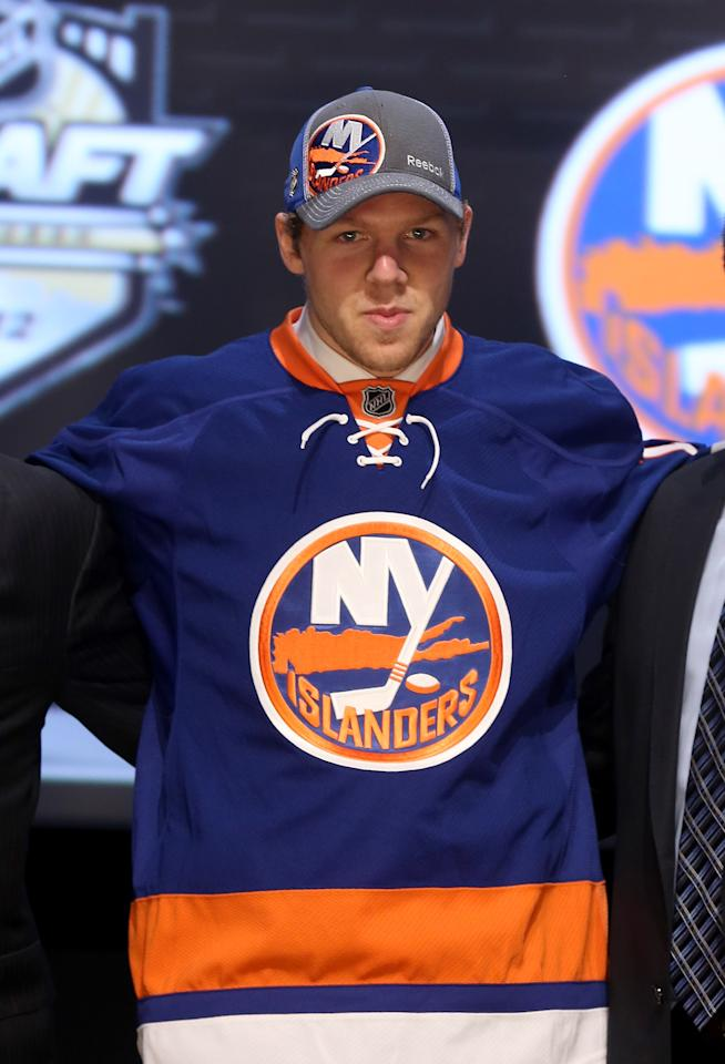 PITTSBURGH, PA - JUNE 22: Griffin Reinhart, fourth overall pick by the New York Islanders, poses on stage during Round One of the 2012 NHL Entry Draft at Consol Energy Center on June 22, 2012 in Pittsburgh, Pennsylvania.  (Photo by Bruce Bennett/Getty Images)