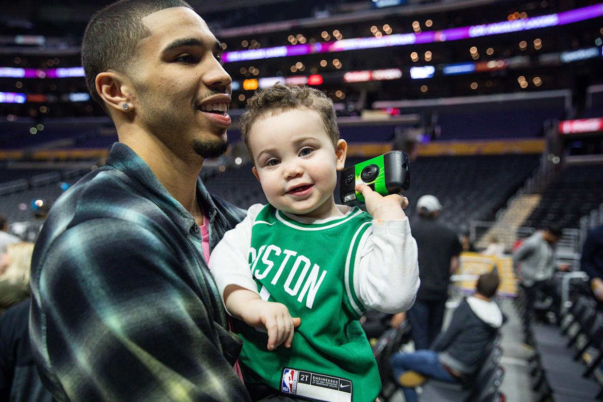 LOS ANGELES, CALIFORNIA - MARCH 09: Jayson Tatum of the Boston Celtics holds his son after a game against the Los Angeles Lakers at Staples Center on March 09, 2019 in Los Angeles, California. (Photo by Cassy Athena/Getty Images)