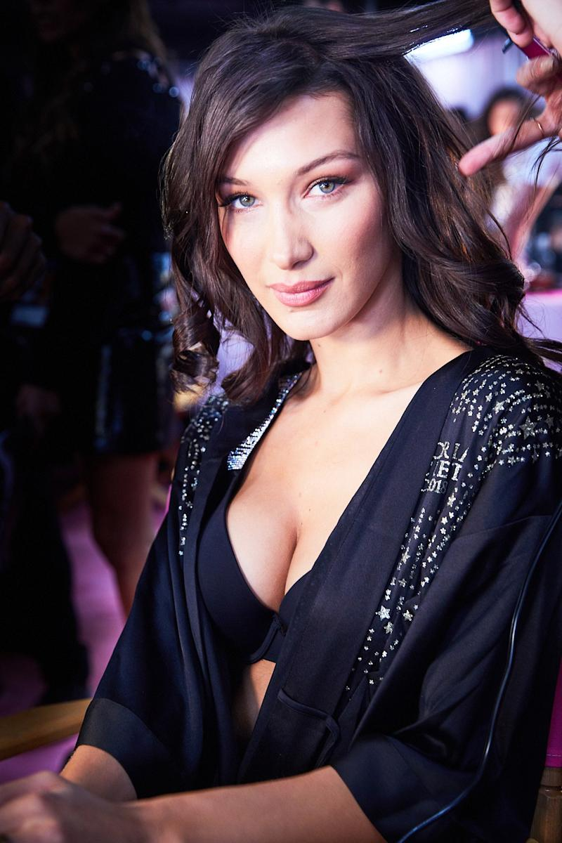 Bella Hadid, getting her hair and makeup done, backstage at the 2018 Victoria's Secret Fashion Show, in New York City, on November 8, 2018. Photograph by Ambra Vernuccio for W magazine.