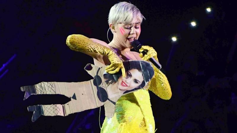 Miley Cyrus Sings 'FU' While Carrying Cardboard Cutout of Selena Gomez